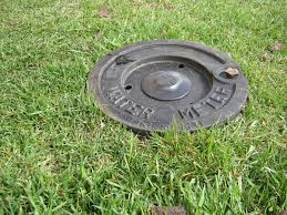 Water meter lid in the grass