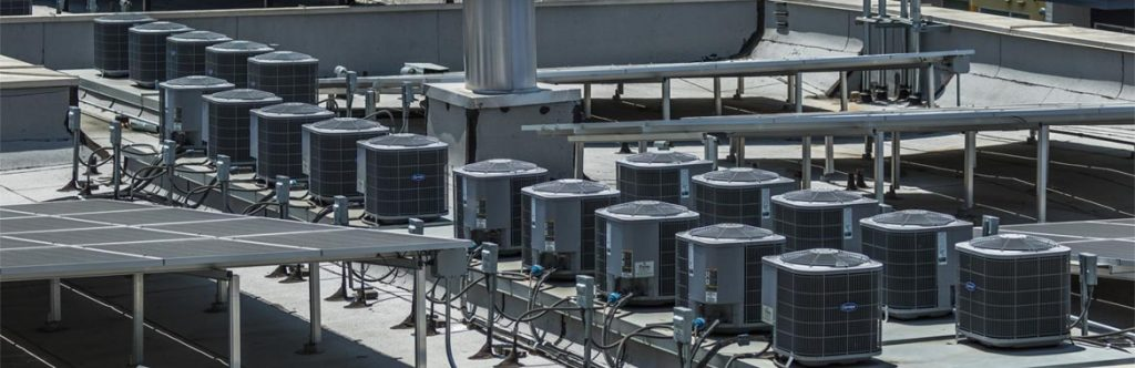 Many rooftop AC units on one site